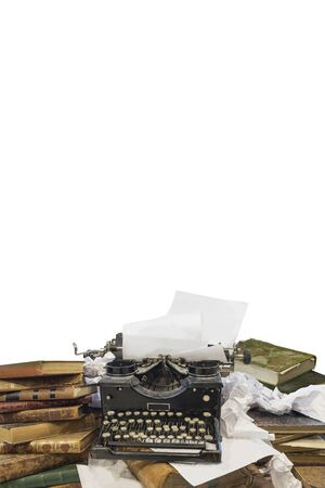 Typewriter on pile of old books and paper with above space