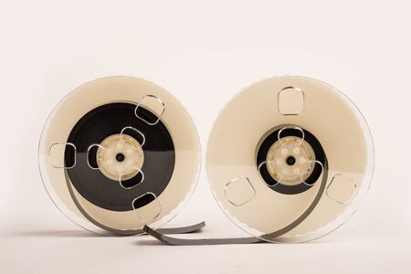 Old video cassette tape with inside film on white background Stock Photo