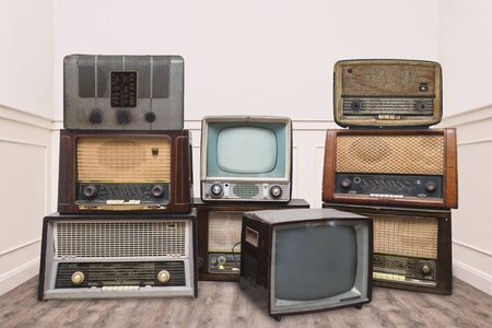 Vintage radios and televisions in a room Stock fotó
