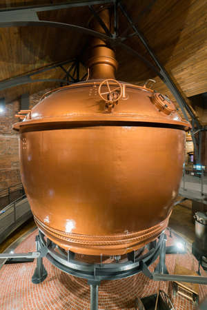Large beer brewing tank in factory