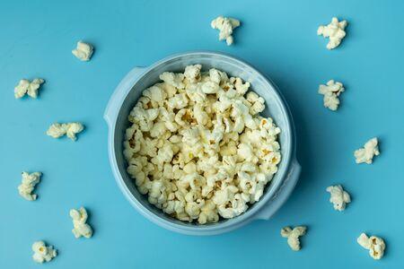 popcorn on bright blue background Stock fotó