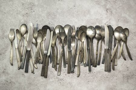Old rusty utensils on gray grungy background
