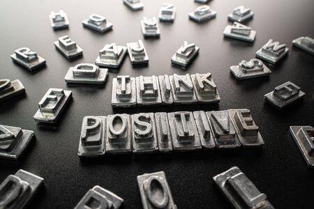 Metal letter formed words think positive
