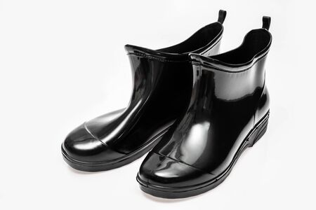 Black rubber waterproof boots isolated on white background