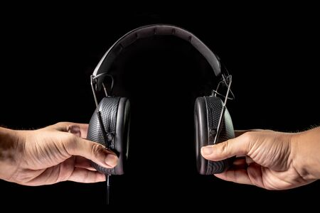 Black headphones in dark environment