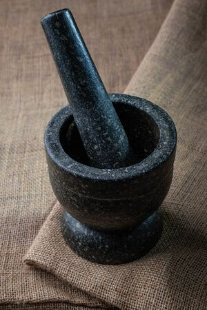 Stone mortar on rustic style fabric