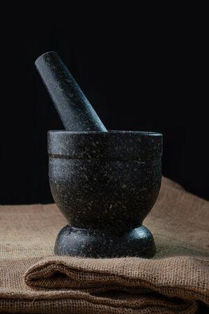 Stone mortar in dark environment Standard-Bild