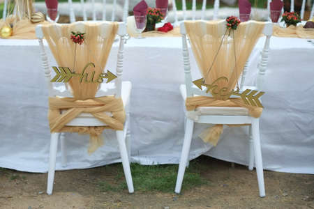 Decorated chairs at the wedding in the park