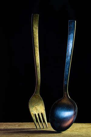 Rusty old fork in dark environment