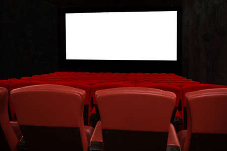 Red seats in theater with white isolated screen Stock fotó