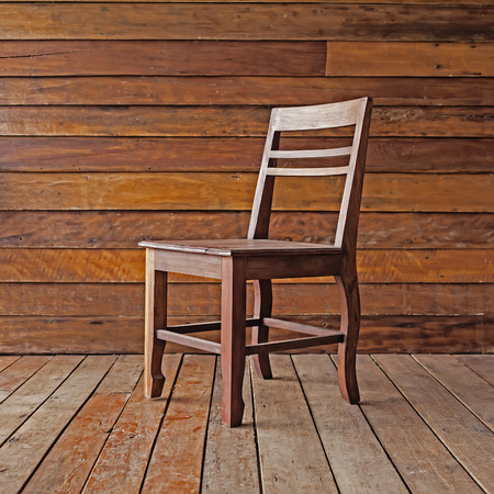 timber bench seat: wood chair on wood background Stock Photo