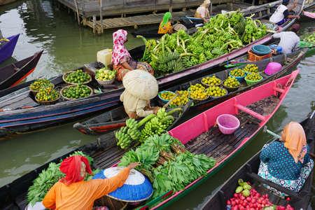 Pasar Terapung or floating market is traditional markets in Banjarmasin, South Kalimantan Editorial
