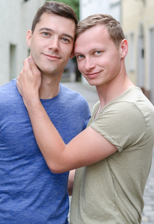 Shot of a young gay couple take a hugging Stock Photo