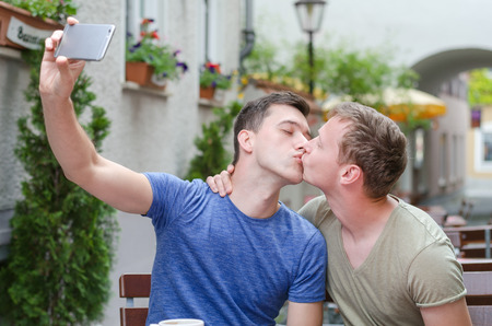 shot of a young couple taking a selfie in a cafe