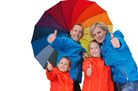 Happy rain family with umbrella show thrumbs up isolated white