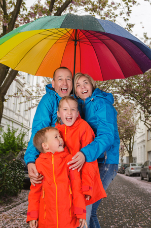 family have fun in rainy day