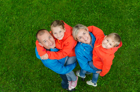 portrait happy family in colorful clothes top view Stock Photo