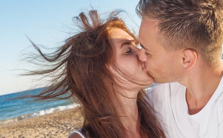 shot of a young couple kissing on the beach