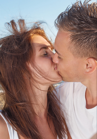 close up shot of a young couple kissing on the beach Stock Photo