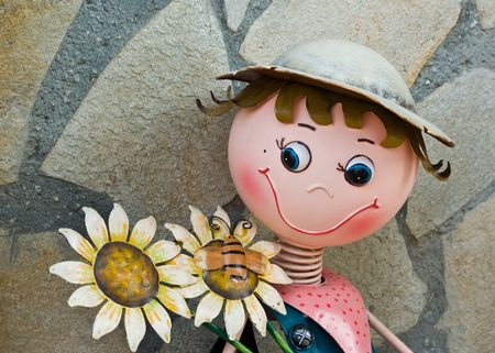 Garden, metal doll with flowers Stock Photo