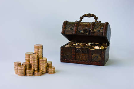 Little chest filled with small, copper coins.