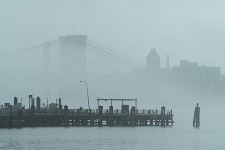 Rainy Manhattan, business district of New York City, heavy fog.