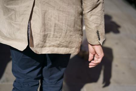 Man in a beige crumpled jacket Zdjęcie Seryjne