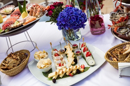 Cheese with pear and strawberries lie on plate