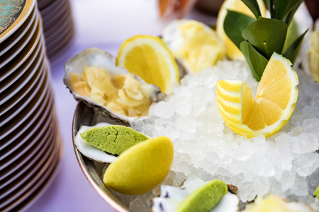 Oysters with lemons served on the restaurant table