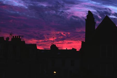 Pink sunset behind the houses Zdjęcie Seryjne
