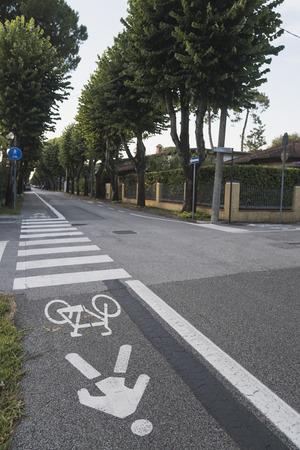 Bicycle road sign painted on sidewalk