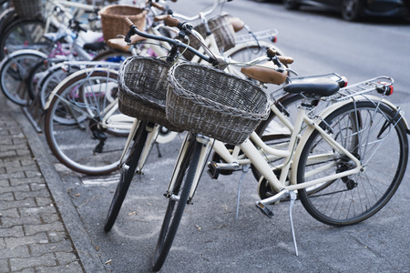 Bicycle parking area with group of bicycles parked together on pavement