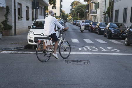 Woman riding bicycle through streets on urban