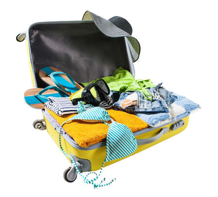 suitcase packing: packing suitcase for vacations Stock Photo