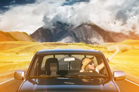 roadtrip: young woman on a roadtrip