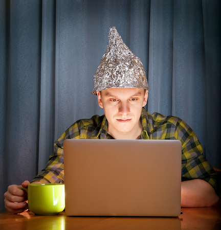 military invasion: tinfoil hat against mass media