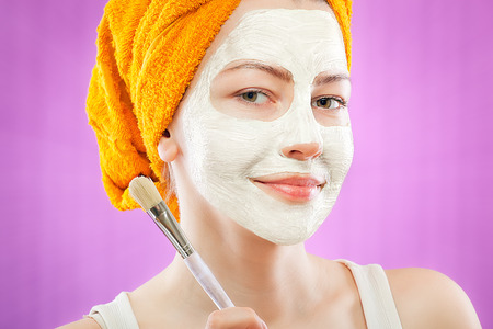 specific clothing: young woman with facial mask Stock Photo