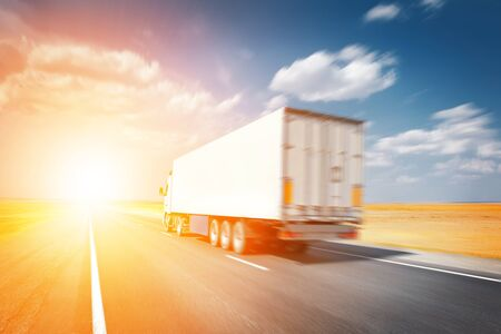 semitruck: semitruck driving to sunset