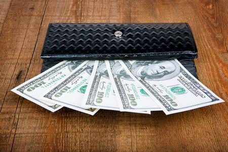 looting: wallet full of money Stock Photo