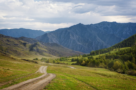 meadowland: dirt road in mountains Stock Photo