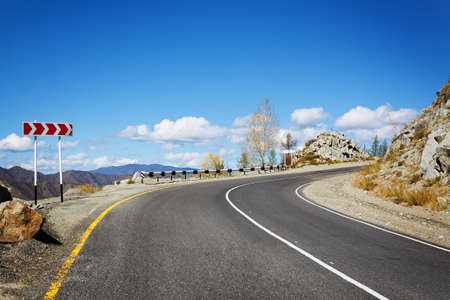 bigger picture: road in mountains Stock Photo