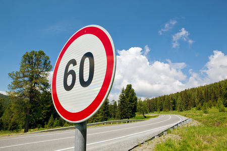 saturated color: speed limit sign on the road