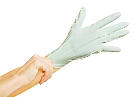 wearing surgical glove