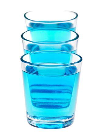shot glasses: shot glasses with blue liquid