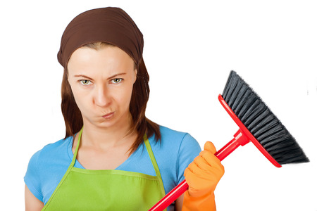 sceptic: sceptic young woman with broom Stock Photo