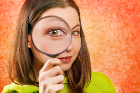 low scale magnification: woman with magnifying glass