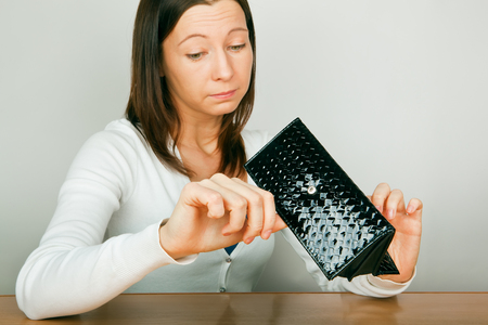 change purse: woman with empty wallet