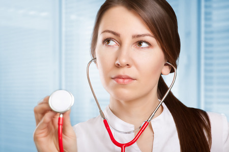 carved letters: young doctor or nurse with stethoscope Stock Photo