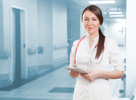 southern european descent: young doctor with digital tablet