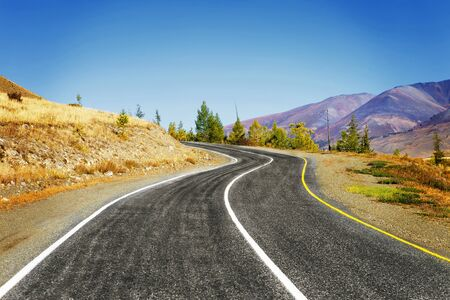 the bigger picture: mountain road Stock Photo